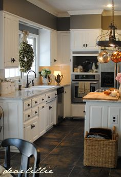 I like the pot rack light fixture combo, and the little lamp illuminating the corner under the cabinet.  I also like the double wide window and farmhouse sink with the oil rubbed bronze hardware.