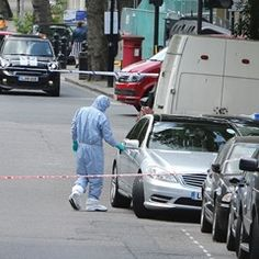 Forensics team inspect suspect package in North London