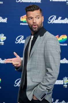 """Singer Ricky Martin attends the """"40 Principales Awards"""" 2013 photocall at Palacio de los Deportes on December 12, 2013 in Madrid, Spain."""