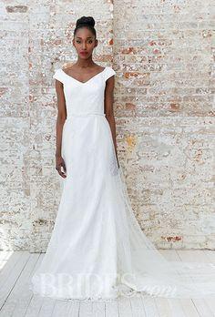 A @jeanralphthurin wedding dress with a portrait neckline | Brides.com