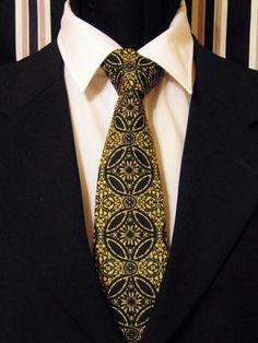 ID# 109FA 100% Cotton Black and Gold Medallion Necktie. Measures: 3.5in Tip Width / Select Length Custom Sizes: This necktie may be custom ordered length and tip width with 1/8in allowance. At EdsNeckties we meet or exceed your expectations. Everything ships within 2 business days of