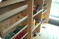 Kind of a neat fold away work table with lego storage bins built in Lego Table With Storage, Lego Storage, Diy Storage, Drop Down Table, Fold Down Table, Wall Mounted Table, Wall Mounted Shelves, Kids Play Spaces, Kids Rooms