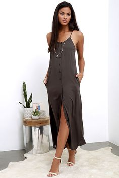 Perfect for even a manic Monday, the Friday I'm in Love Charcoal Grey Maxi Dress will put you in a weekend mood! Woven rayon is soft and lightweight over spaghetti straps, a modified racerback, and relaxed bodice with full button placket. Maxi skirt has hidden side seam pockets and twin side slits.