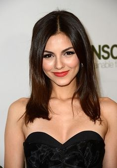 The deep rose lipstick Victoria Justice chose compliments her dark hair and brows.