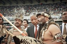 Nelson Mandela President of the African National Congress (center) talks with Jacob Zuma, right, a ranking Zulu in the ANC before making a speech before some 80,000 ANC supporters at a rugby field on Sunday, Oct. 24, 1993 in Durban, South Africa.   Man on left is Jeff Hadebe , the ANC  Chief of Southern Natal. Photo: David Brauchli, Wire / AP1993