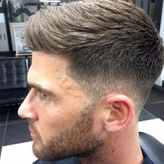 The close taper to longer top is done well here. Short beard just adds to the masculine look.