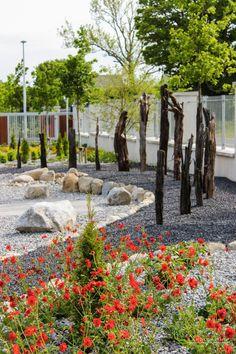 Celtic Stone Carving and Bog Oak. Garden Design, by Tom Leavy_ Leavy Landscape Design, Garden Design, Ireland Landscape, Stone Carving, Garden Landscaping, Celtic, Sidewalk, Meet, Construction