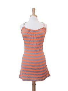 Casual yet vibrant, this dress is great for all summer time activities.  Braided rope extends from the shoulders down the back.