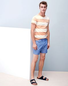 "J.Crew men's sun-faded pocket in surf stripe tee, 6.5"" tab short in chambray swim, and Birkenstock for J.Crew Arizona sandals. To preorder call 800 261 7422 or email verypersonalstylist@jcrew.com."