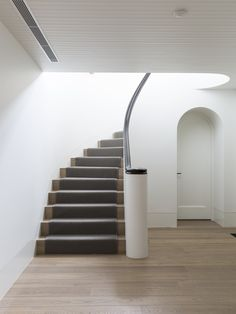 Feature | Stairs | Staircase | Plaster Walls | Curved | Geometric | Design | Architecture | Melbourne | Adelaide | Gold Coast | Australia | Balustrade | Floorboards | Timber | Stained | Handrail | Scroll | Contrast | White | Gloss | Light