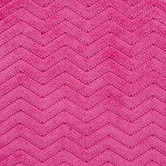 Bronx Fabric is a piece-dyed corduroy pile from Covington Fabric & Design. Woven from a soft polyester with a nylon knit backing, this fabric features a small-scale chevron design.