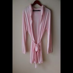 """Pink robe Pink colored hooded robe - long sleeves - self tie belt at waist - rayon/polyester - new without tags - total length measures 35"""" - size L/XL Xhilaration Intimates & Sleepwear Robes"""