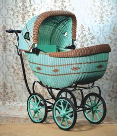 Vintage green wicker doll / baby buggy carriage.  Love this!