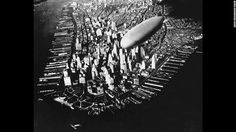 This aerial photograph from 1910 shows a Zeppelin dirigible flying over Manhattan.