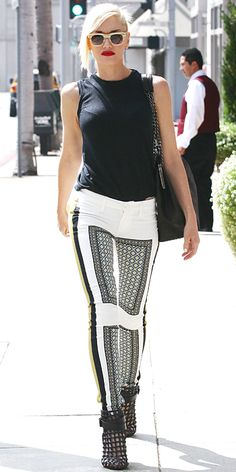 Gwen stefani  took to the streets in a pair of printed white pants that she styled with a sleeveless black top and caged booties.