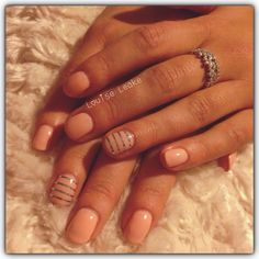 Peachy Shellac nails with striping tape.