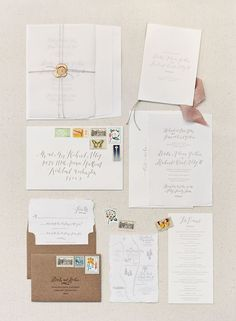 Brita and Richie's Stunning Pacific Northwest Wedding by O'Malley Photographers | An elegant, simple wedding invitation suite with hand lettering and vintage stamps was fitting for this sophisticated backyard wedding.