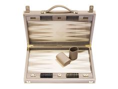 Backgammon Board. I love backgammon but this board costs almost $7,000 dollars. That's absurd. I don't care how wealthy you are. Splurge on a $1,000 dollar board and give the other $6,000 to a charity. Don't mean to offend anyone, just the opinion of a logical realist.