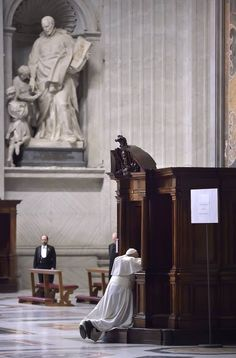 Pope Francis goes to confession during a Lenten penance service in St. Peter's Basilica at the Vatican March 13. During the service the pope announced an extraordinary jubilee, a Holy Year of Mercy, to be celebrated from Dec. 8, 2015, until Nov. 20, 2016. (CNS photo/Stefano Spaziani, pool) See POPE-PENANCE March 13, 2015. — in Vatican City.