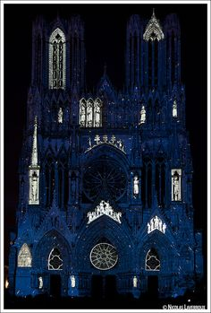 """Video projection """"Dream Color"""" on the façade of the Cathedral of Reims, France"""
