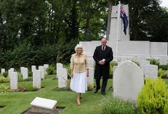 Camilla Duchess of Cornwall visits the Commonwealth War Graves at St Nicholas' Church on July 26 2016 in Brokenhurst England