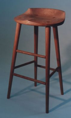 Tractor seat stool by Richard Bissell Fine Woodworking of Putney VT. Available in many woods like cherry maple oak walnut & mahogany. Handmade Furniture, Custom Furniture, Wood Furniture, Furniture Makers, Woodworking Furniture, Fine Woodworking, Tractor Seat Bar Stools, Workshop Stool, Mission Furniture