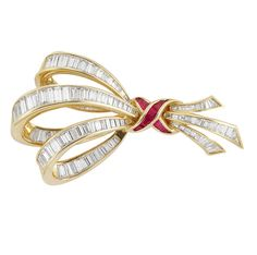 Gold, Diamond and Ruby Bow Brooch   18 kt., 119 diamonds ap. 6.75 cts., ap. 12 dwt.
