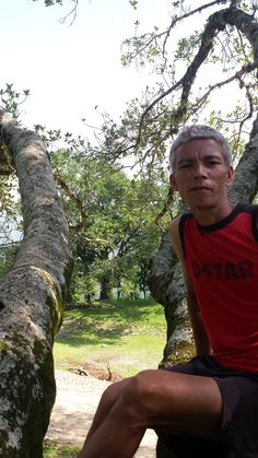 Local Nepali tour Guide in tree on Mountian top, Gorkha, Nepal