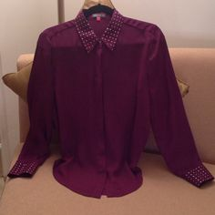 Vince Camuto - Designer Blouse Beautiful Sheer Purple Blouse by Vince Camuto. In excellent condition. Worn once! Size Medium. This is absolutely gorgeous with the tiny Gold nail heads on the collar and the cuffs. Hidden button's front. Great tucked in your pencil skirts or Black pants. But it's cute worn 'untucked' with a Gold chain belt. Vince Camuto Tops Blouses