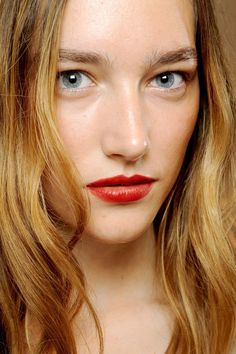 SS13 Burberry make-up. Perfect red lip next to the perfect natural skin. Found on Glamour.