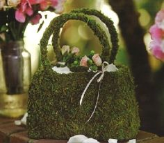 Definitely unique...moss covered purse for flower girls