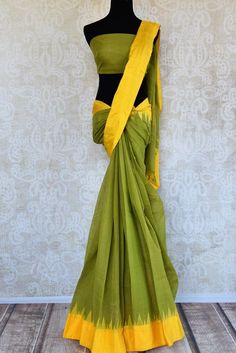 Simple yet striking ikkat khaddi saree is a perfect drape for casual affairs! The saree has a bright pop of yellow border which adds a striking contrast. It comes with a green blouse piece. Shop online from Pure Elegance or visit our store in USA! Green Saree, Green Blouse, Elegant Outfit, Blouse Styles, Ikat, Sarees, Contrast, Bright, Indian