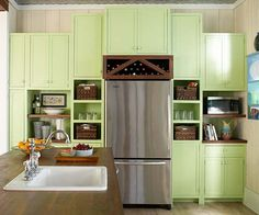 Add visual interest to your kitchen with great colored cabinets. More kitchen update ideas: http://www.bhg.com/kitchen/remodeling/makeover/low-cost-ideas/?socsrc=bhgpin010414coloredcabinets&page=14