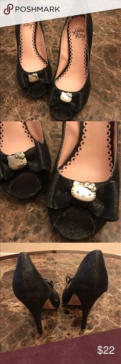HELLO KITTY PEEP TOE HEELS HELLO KITTY PEEP TOE HEELS. THESE HAVE A SUBTLE BLACK GLITTER. SEE PIC, SLIGHT HEEL DAMAGED ON THE SIDE. NOT NOTICEABLE WHEN WEARING THEM. Hello Kitty Shoes Heels