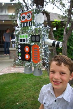 Robot Birthday Party - The Pinata.  I bet your dad would love to make this.  A robot pinata for your graduation??