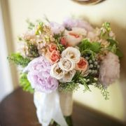 Stock with coral roses and soft ivory roses. Garden roses too.