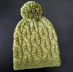 Cables, cables everywhere! Stretchy and squishy, this warm winter hat is great in DK and light-worsted weight yarns. Finish it off with a big pompom for even more fun.