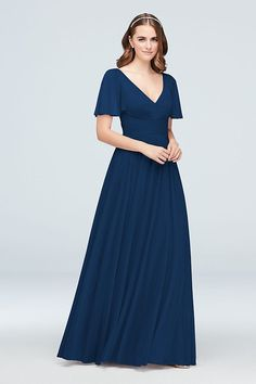 3b4c07e4687 With a flattering crisscross waistband and flowing flutter sleeves