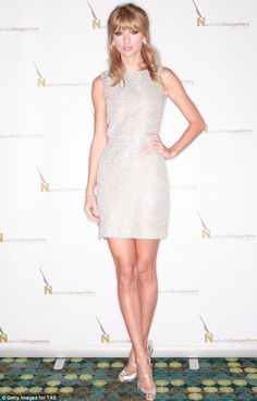 What an achievement: Taylor Swift sparkled in silver as she became the only person to ever be named the Nashville Songwriters Association In...