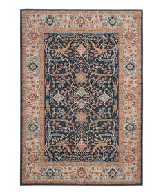 A colorful geometric pattern makes this intricate rug an effortless way to liven up a room's look while unifying modern décor.