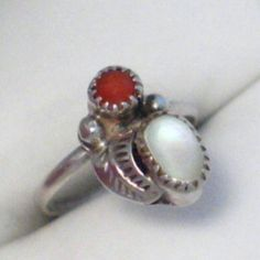 Vintage Beautiful Native American Coral/MOP Ring This is a Sterling Silver ring that is a size 2. You can wear it as a pinky rlng or over the knuckle ring. Vintage from the 70's Vintage Jewelry Rings