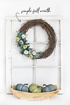 Learn how to make a fall wreath that is affordable, simple and beautiful. With a few supplies and 15-20 minutes, you'll have a new fall wreath for your front door or to display in your home. More at livelaughrowe.com #FallWreath #FallWreathForFrontDoor #FallDecor