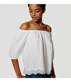 In pure cotton, this romantic off the shoulder eyelet style sweeps us off our feet. Elasticized off-the-shoulder neckline. Elbow sleeves with elasticized cuffs. Shirred detail.