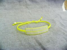 Bright Neon yellow cord macrame vivid adjustable bracelet with white glass tube bead and white glass round beads, delicate and show stopping by modernmelon on Etsy