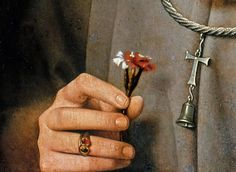 Detail of Man with pinks by Jan van Eyck.