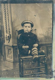 Vintage photo boy with striped stockings