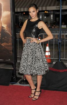 Pin for Later: You Only Need 13 Reasons to Start Obsessing Over Gal Gadot's Style  For the Los Angeles premiere of Riddick, Gal mixed materials, opting for an ensemble that included a leather top and a full, patterned skirt.