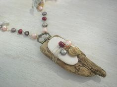 Statement Necklace Upcycled Driftwood Sea Pottery Seashell Pearl Necklace. $40.00, via Etsy.