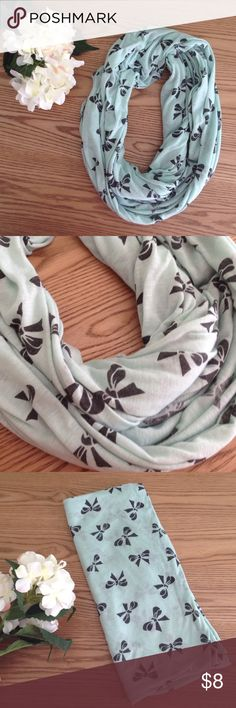 Infinity Scarf This is a beautiful yet simple infinity scarf. It's a light turquoise/aqua color with black bows. Buy it by itself or add it to any clothing item for half off!  ⚡️Fast Shipping⚡️ 💕Open to Fair Offers 💕 🛍 Discount off Bundles🛍 🚫No Trades or Paypal🚫 💋Smoke Free Home💋 Charlotte Russe Accessories Scarves & Wraps