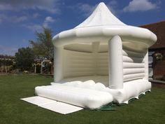 white bouncy castle in the garden